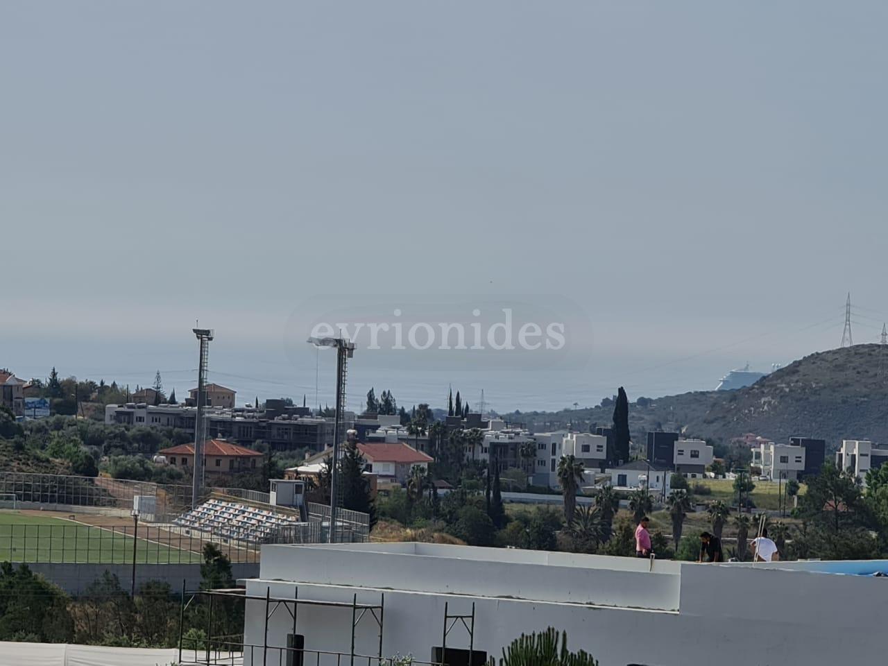 Corner plot of land with sea view in Moni